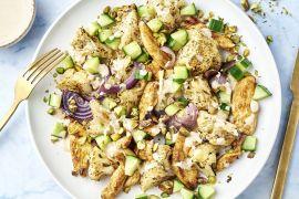 Foto van Libanese geroosterde bloemkoolsalade met kip en tahindressing