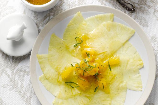 Ananascarpaccio met mangodressing