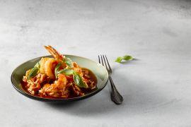 Foto van Spaanse wok met rijst en scampi's