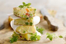 Foto van Tortilla met ui en paprika