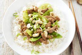 Foto van Wok van varkensvlees met peultjes en rijst