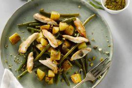 Foto van Kruidige kip met groene boontjes en pistaches