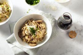 Foto van Fettucini met balsamico champignons