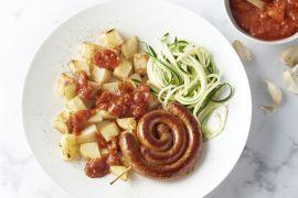 Foto van Patatas bravas met merguez en courgettespaghetti