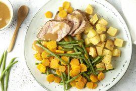 Foto van Rosbief met boontjes, worteltjes en geroosterde aardappelen