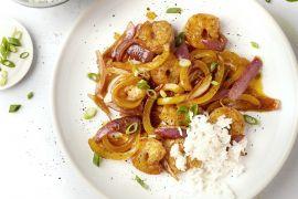 Foto van Gewokte scampi's met paprika en rijst