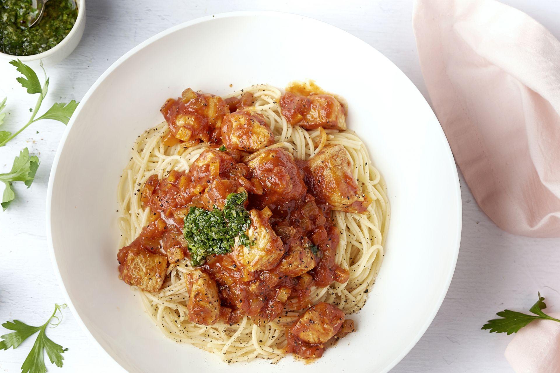 Varkensblokjes in osso bucco-saus met gremolata en spaghetti
