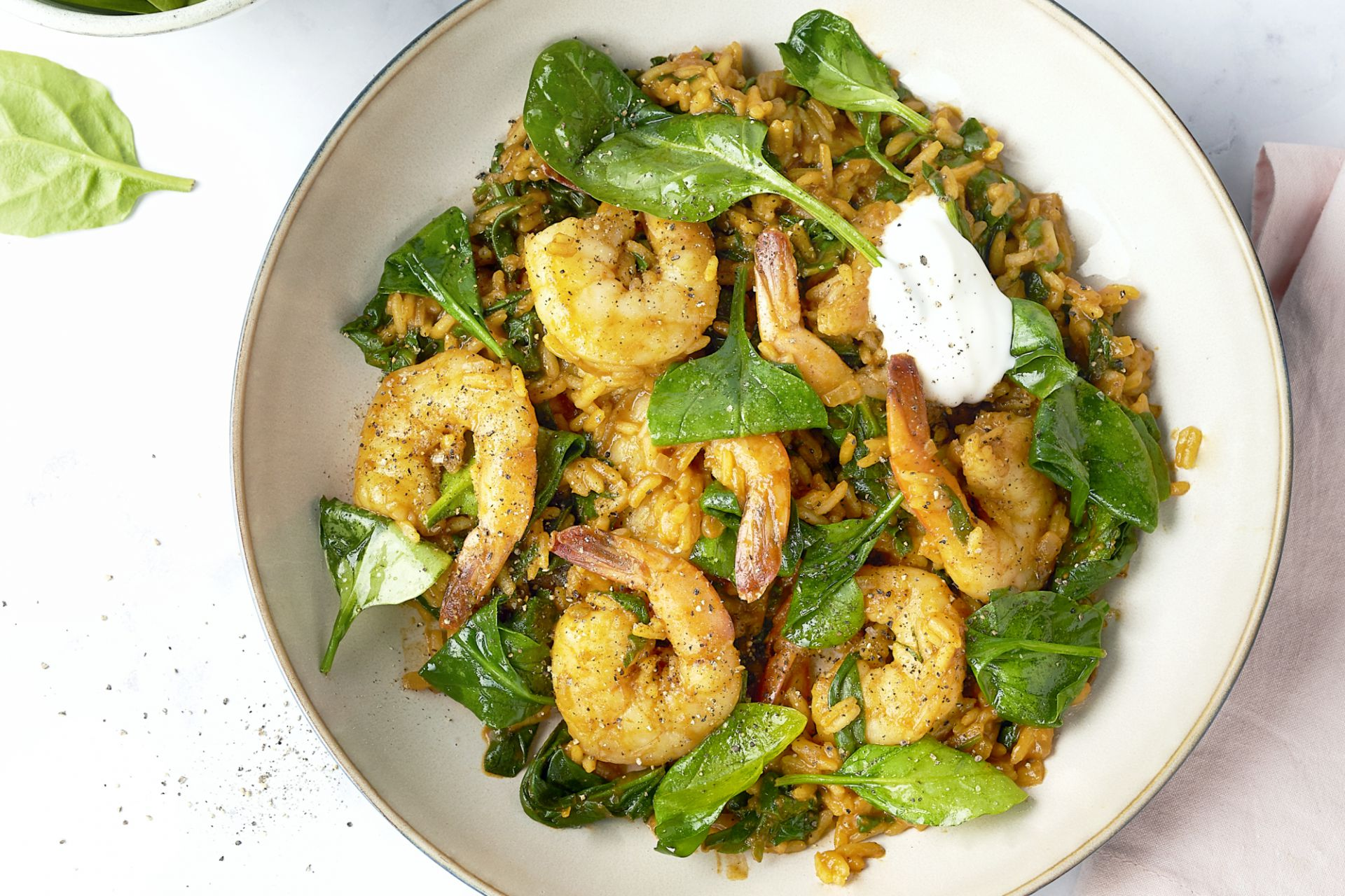 Biryani met scampi's en spinazie