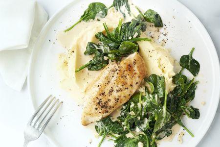 Kip met knoflookpuree en spinazie