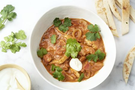 Snelle Indische curry met kip en tomaat