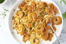 Foto van Linguine met scampi's in tomatenroomsaus