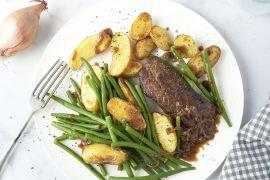 Foto van Steak met boontjes, sjalotten-balsamicosaus en geroosterde krieltjes