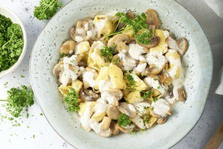 Tortellini met champignons en kruidenkaas
